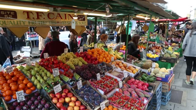 tf cain sells quality fruits and produce from a portobello stand portobello road market fresh fruit stand on october 01 2012 in london - greengrocer's shop stock videos & royalty-free footage