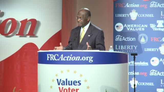 vídeos de stock e filmes b-roll de cain talks about how he is on a journey to the white house just as the title of his book says walks off stage presidential candidate herman cain at... - política e governo