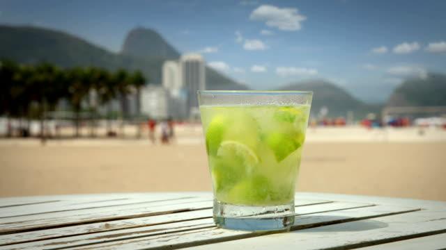 caipirinha cocktail on copacabana beach, rio de janeiro - cachaça stock videos & royalty-free footage