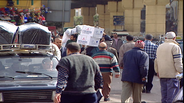 cairo scenes cu on a very busy shopping street full of hawkers vendors and traffic in cairo - door to door salesperson stock videos & royalty-free footage