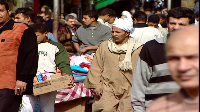 cairo scenes panleft on a very busy shopping street full of hawkers vendors and shoppers in cairo - door to door salesperson stock videos & royalty-free footage