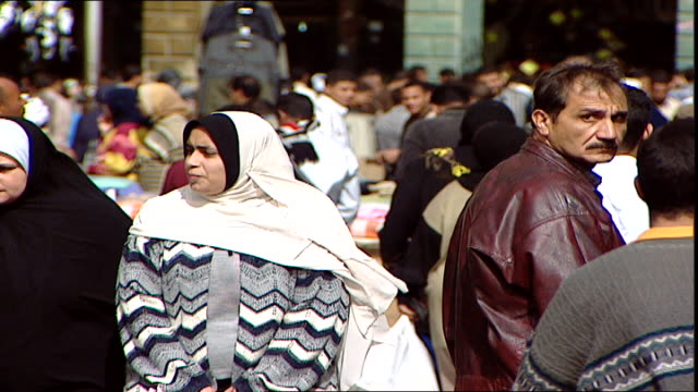 cairo scenes scene of a very busy shopping street full of people in cairo - door to door salesperson stock videos & royalty-free footage