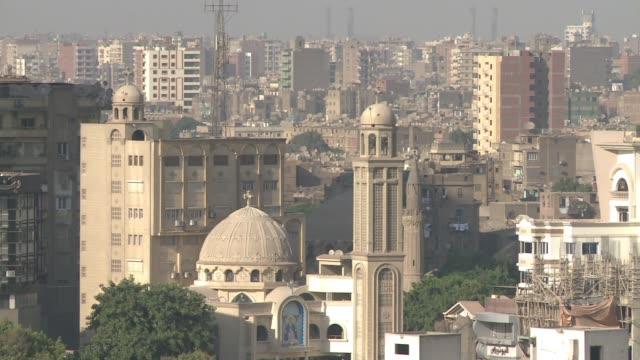 Cairo skyline pan to bridge Coptic church and traffic