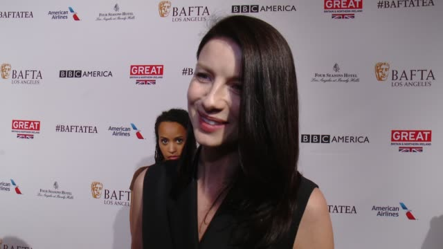 vídeos de stock, filmes e b-roll de interview caitriona balfe on being at the event on her series 'outlander' and on preparing for the golden globes at the bafta los angeles awards... - tea party