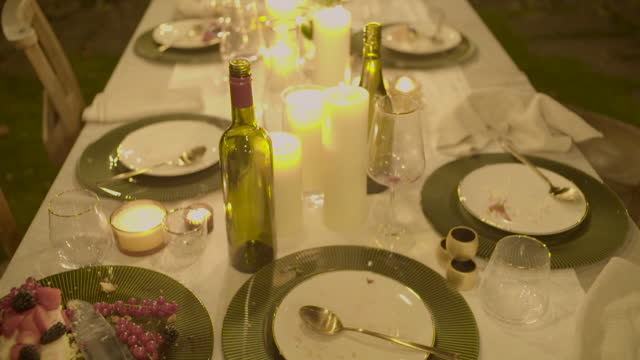 cake and empty plates after a garden dinner party - overexposed stock videos & royalty-free footage