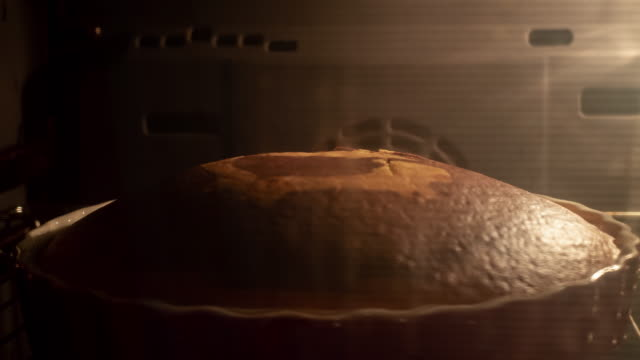 cake baking in the oven - baking stock videos & royalty-free footage