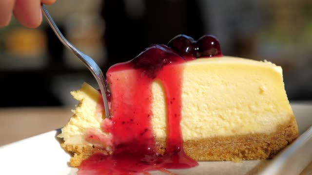 cake cutting strawberry cheesecake with red jam , slow motion - strawberry jam stock videos & royalty-free footage