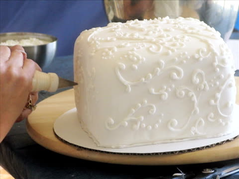 cake decorating (pal) - decorating a cake stock videos and b-roll footage