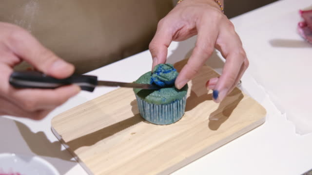 cake decorating - blueberry muffin stock videos & royalty-free footage