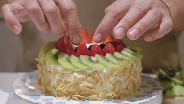 cake decorating - decorating a cake stock videos and b-roll footage