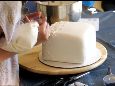 cake decorating--time lapse (ntsc) - decorating a cake stock videos and b-roll footage
