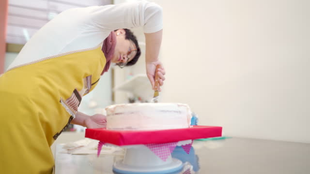 cake is almost ready - decorating a cake stock videos and b-roll footage