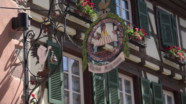 cake shop sign with half-timbered house - french bakery stock videos & royalty-free footage