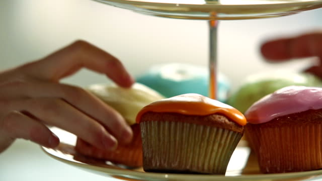 cake stand of cup cakes - icing stock videos and b-roll footage
