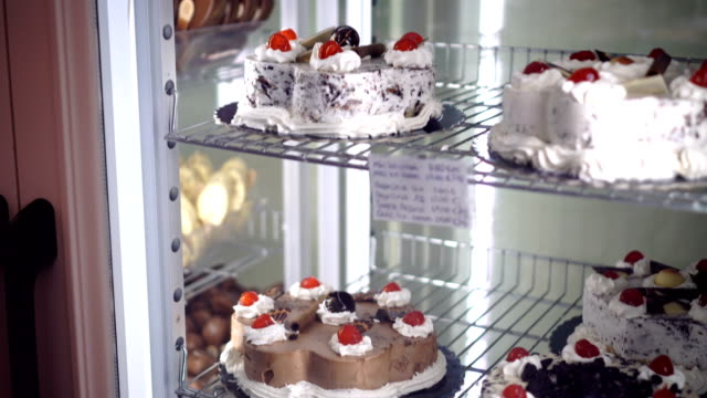 cakes in pastry shop - dairy product stock videos & royalty-free footage