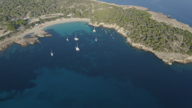 cala bassa - ibiza. 4k - bay of water stock-videos und b-roll-filmmaterial
