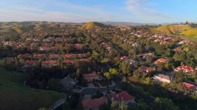calabasas city in santa monica mountains, los angeles county, california, usa. aerial video with the panning camera motion. - santa monica house stock videos & royalty-free footage