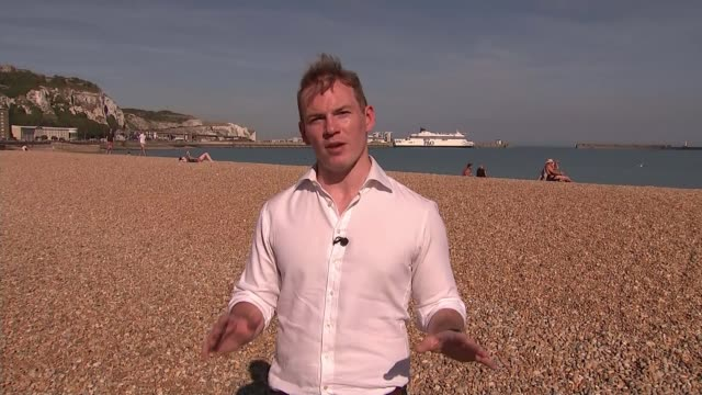 amber rudd meets with french interior minister; england: kent: dover: reporter to camera people along on beach with harbour walls in background... - deck chair stock videos & royalty-free footage