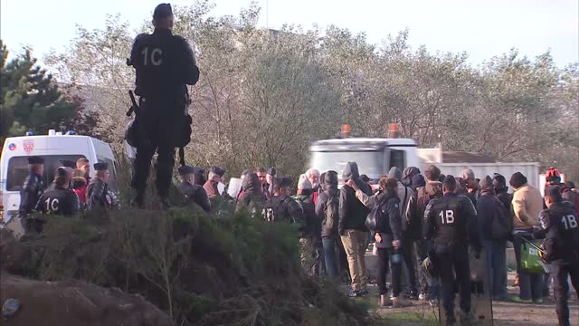 calais' deputy mayor has told sky news that the french government must take responsibility for the hundreds of people who still remain at the jungle... - calais stock videos and b-roll footage