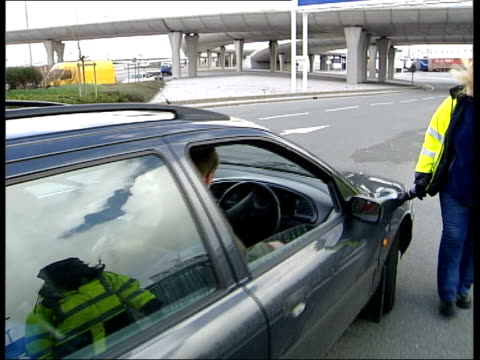 calais ext side english immigration officer stopping driver asking to look in his boot sot immigration control officer inside booth female officer in... - zoll und einwanderungskontrolle stock-videos und b-roll-filmmaterial