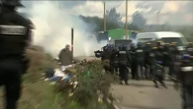violent clashes between migrants and police france calais ext various of migrants and refugees who live in the camp known as the jungle protesting... - calais stock videos and b-roll footage