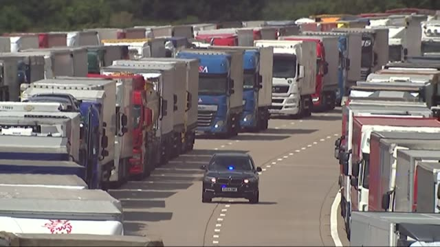 operation stack in kent england kent m20 ext general views of lorries queuing and parked up on m20 during operation stack / lorry drivers chatting in... - calais stock videos and b-roll footage