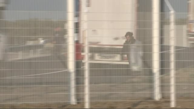 secure zone to be set up by uk government france calais ext migrants being chased out of secure zone by french police - calais stock videos and b-roll footage
