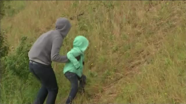strike ends but migrant problem continues france calais port of calais ext group of migrants at roadside near port area young boy with them - calais stock videos and b-roll footage