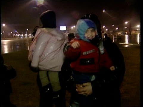 refugees towards carrying young children - calais stock videos & royalty-free footage