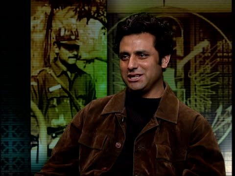 militant kashmiri attack itn england london gir int muzamil jaleel interview sot talks of kashmiri militant groups wanting a war between india and... - westbengalen stock-videos und b-roll-filmmaterial