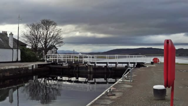 caledonian canal locks and railway swing bridge at clachnaharry, inverness - swing bridge stock videos & royalty-free footage