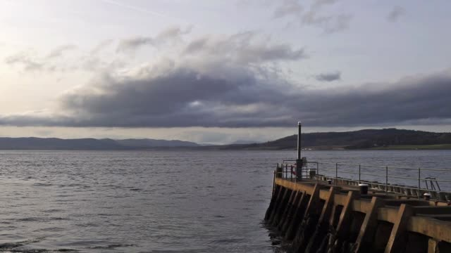 caledonian canal sea lock pier at clachnaharry, entering beauly firth, inverness - inverness scotland stock videos & royalty-free footage