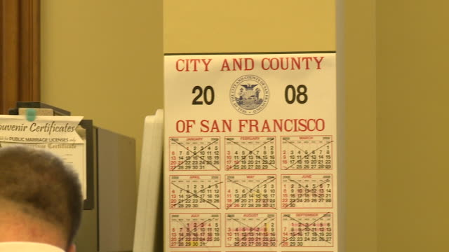 calendar on wall at county clerk's office in san francisco city hall/ male couple applying for wedding license/ san francisco, california/ audio - formal businesswear stock videos & royalty-free footage