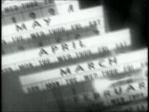 stockvideo's en b-roll-footage met b/w 1938 multiple exposure calendar pages go by as pendulum swings in foreground - 1938