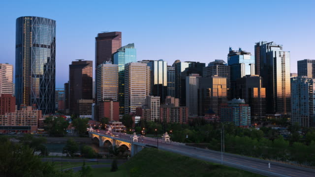T/L Calgary skyline and the Centre Street Bridge over the Bow River at sunset