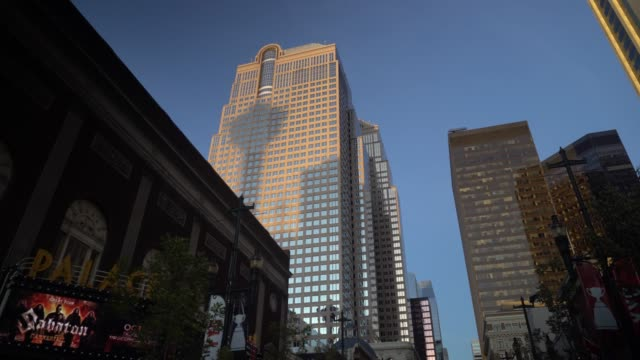 calgary tower shadow cast on a building at dawn. - calgary stock videos & royalty-free footage