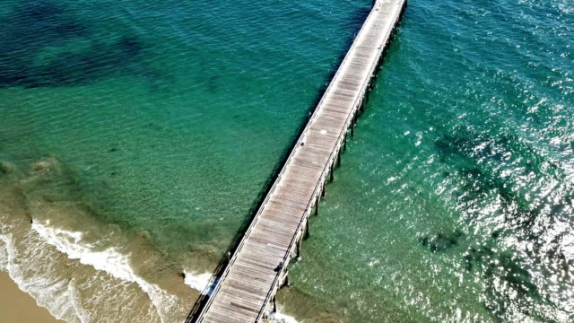 california coastline with mountains and pier from above - monterey county stock videos and b-roll footage