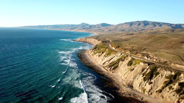 california coastline with mountains and train tracks from above - rail transportation stock videos & royalty-free footage
