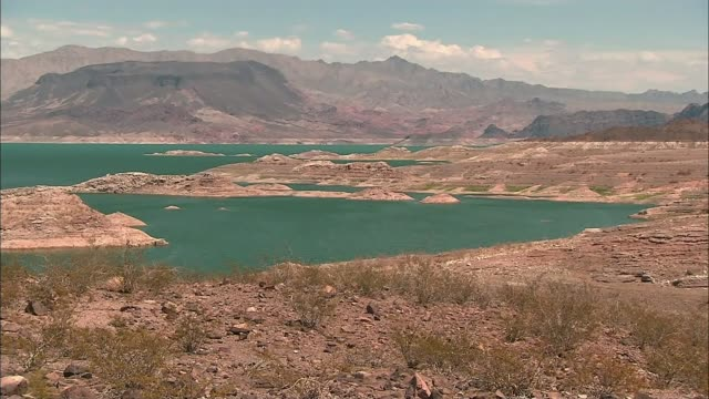 new water restrictions imminent gv reservoir with low water levels in desert landscape - bacino idrico video stock e b–roll