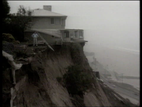 california earthquake: aftermath; b)naf: usa: california: los angeles: ext waves of pacific ocean onto beach lagv house precariously perched on each... - jack nicholson stock videos & royalty-free footage