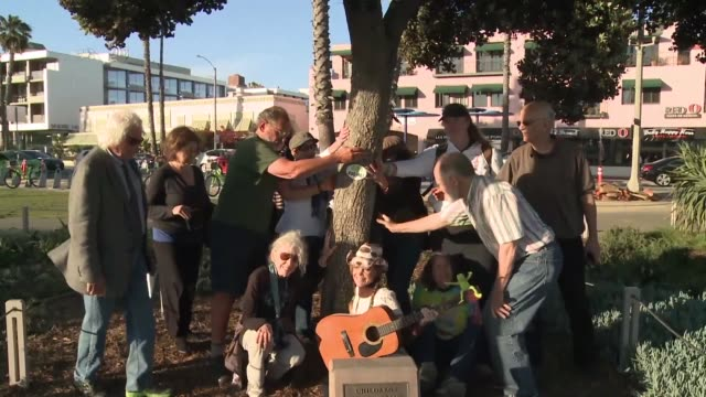California environmental activists celebrate the start of spring by displaying their affection at this year's Tree Hugging Day celebration in Santa...