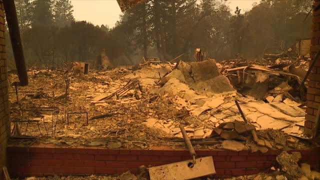california fire official says he has reports of several hundred structures that have been destroyed in a northern california town ravaged by a... - camp fire stock videos & royalty-free footage