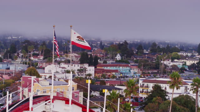 California Flag and Stars and Stripes Waving Atop Rollercoaster in Santa Cruz - Drone Shot