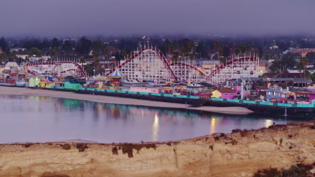 california flag waving over rollercoaster on santa cruz boardwalk - drone shot - boardwalk stock videos & royalty-free footage