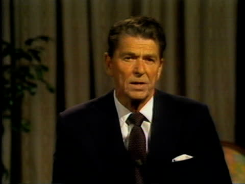 california governor and u.s. presidential candidate ronald reagan leaning against desk in a personal office. he speaks about his convictions on peace... - leaning stock videos & royalty-free footage