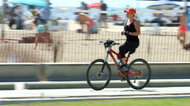 California healthy lifestyle, people walking and riding bicycles on Santa Monica Beach, Los Angeles, California