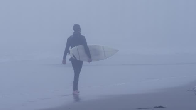 usa, california, huntington beach, surfer looking at waves - huntington beach california stock videos and b-roll footage