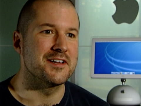 California Jonathan Ive interview SOT EXT MS Approach to entrance to Apple HQ with sign outside TRACK GV Apple HQ CMS Old Apple Mac Computer TRACK...