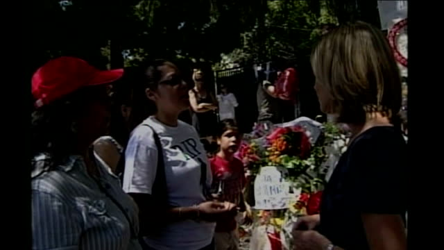 los angeles: ext shrine outside jackson family home / reporter to camera / aurora garcia and victoria garcia interview sot cutaways messages from... - mary nightingale stock videos & royalty-free footage