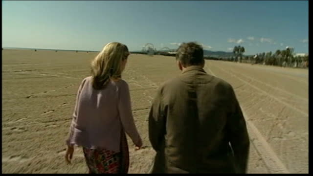 los angeles: hollywood: ext nick parks along beach with reporter - animator stock videos & royalty-free footage